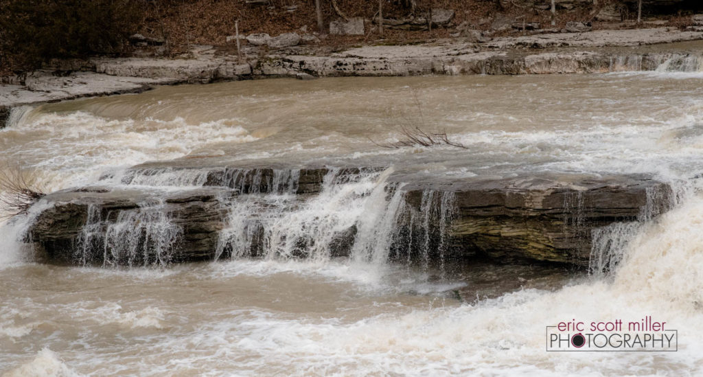 "One capture of a ""mini fall"" as the water flows downstream."