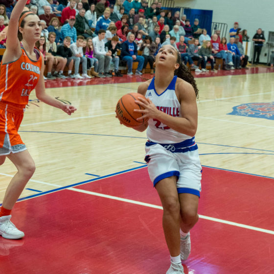 Kayana Traylor drives to the basket against Columbus East during Senior Night.