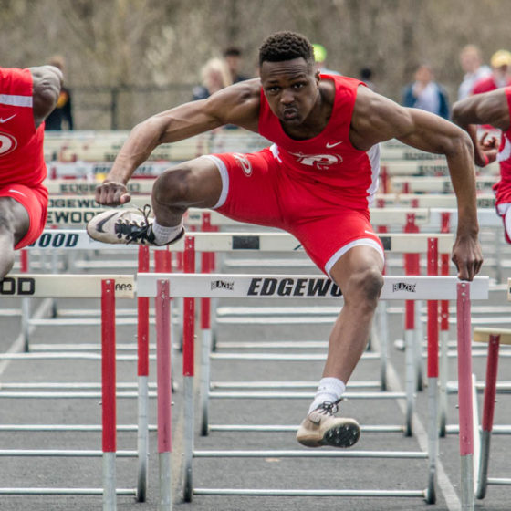 Hurdlers from Pike High School compete side-by-side.