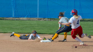 A diving defensive effort beats the runner at second.